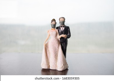 Miniature people : Happy bride wearing masks to protect against viruses during wedding time. People wear masks to prevent New type COVID-19 pneumonia. Coronavirus and Covid-19 concept. Selective focus