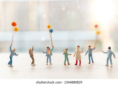 Miniature people : Happy family walking with balloons ,  Happy family Concept