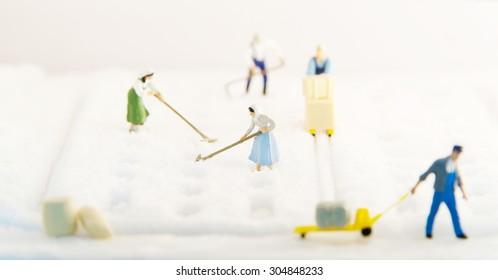 Miniature people harvesting Salt