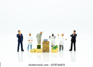 Miniature people: Indirect Channel for sell product to consumer by merchant. Image use for business market concept.