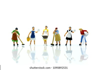 Miniature people : Maid or Housewife cleaning on white background.