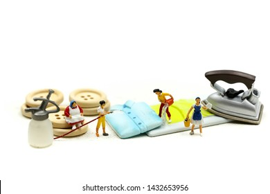 Miniature people : Maid or Housewife cleaning cloth washing with ironing clothes iron in laundry at home.