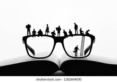 miniature People making a break on glasses