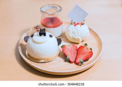 Miniature people making cake