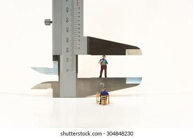 Miniature people making ID card