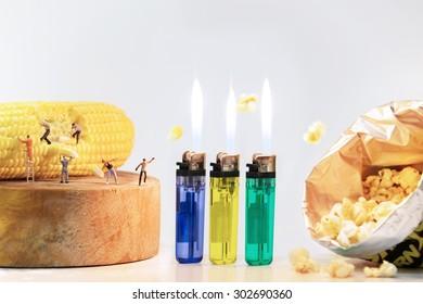 Miniature people making popcorn