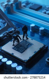 Miniature people : man with gun on the electronic main board computer for hacking data