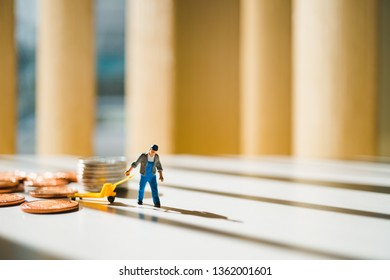 Miniature people, man pulling stack coins, using for logistic, business and finance concept