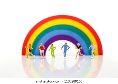 Miniature people : marathon runners with rainbow, jogging and running,healthy lifestyle and sport concepts.