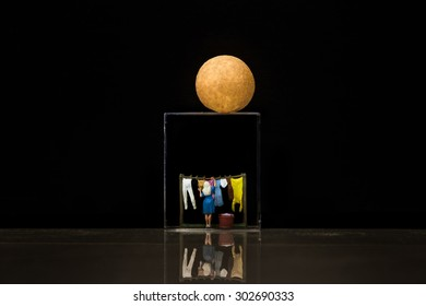Miniature people with the moon