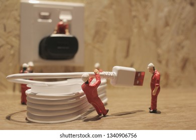 the Miniature people Network Engineers At Work