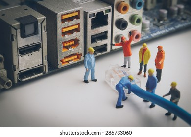 Miniature people  Network Engineers At Work