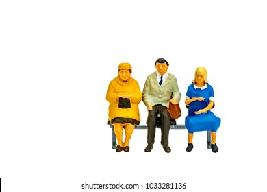 Miniature people office, worker and business sit on chair concept in variety action on white background with space for text