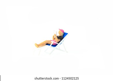 Miniature people office, worker and swimming beach sport concept in variety action on white background