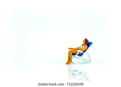 Miniature people office, worker and swimming beach sport concept in variety action on white background with space for text