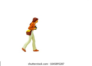 Miniature people office, worker, and traveler concept in variety action on white background with space for text