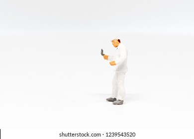 Miniature people Paint worker construction concept on white background with a space for text