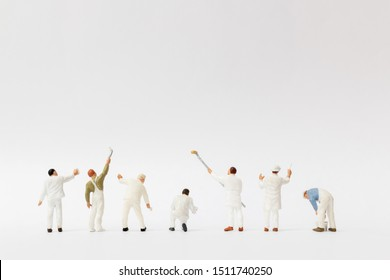 Miniature people : Painter holding a brush with  space for text