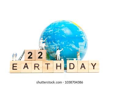 Miniature people : Painters painting on The globe on white background , Earth day concept
