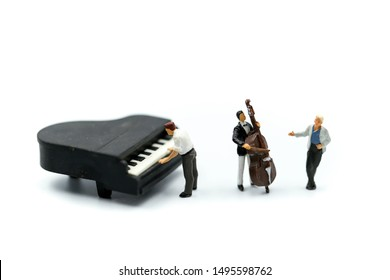 Miniature people : pianist playing piano and Violinist Man,playing musical instrument concept.
