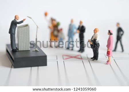 Miniature people : politician or party candidate in excited speech persuades to vote for him. Election debates or press conference concept
