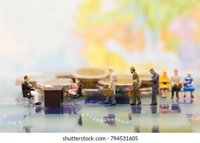 Miniature people: Recruiter interview applicants. Image use for background Choice of the best suited employee, HR, HRM, HRD, job recruiter concepts.