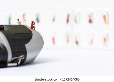 Miniature people: the recruiter sitting on top of binoculars for finding the candidates in the capsules on the wall, recruitment process, HR, HRM, HRD concepts.