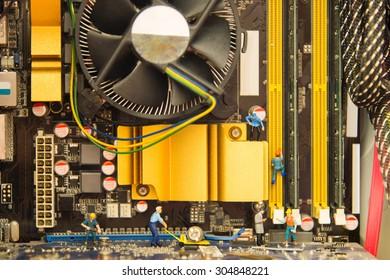 Miniature people repair computer