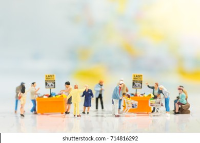 Miniature people: Shopper In shopping mall using as background business, marketing concept.