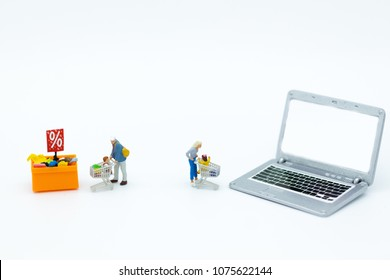 Miniature people : Shoppers for online and offline businesses. Image use for retail business, marketing place concept.