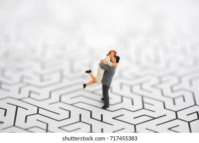 Miniature people: Small couple figures in love using as background Love and Valentine's day concepts.
