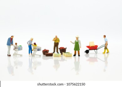 Miniature people : Spending cash for shopping in the market. Image use for marketing, merchant middleman,retail business concept.