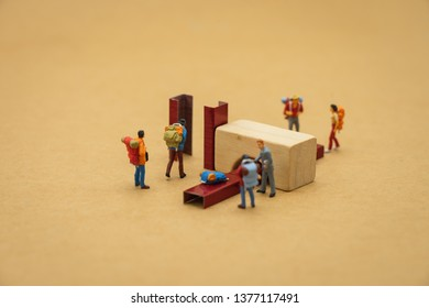 Miniature people stand on Walk through the scanner before entering the airport gate. using as background  travel concept with copy spaces for your