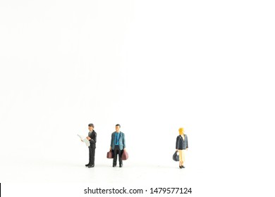 Miniature People Standing Below a Graph Fluctuating up and down
