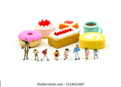 Miniature people : student and children with desserts,Fun and eating concept.