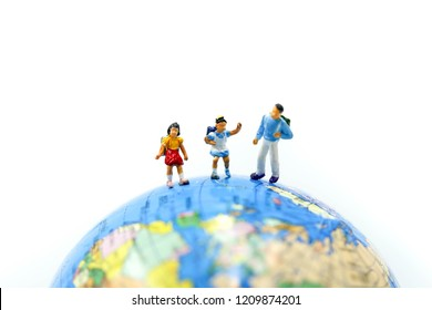 Miniature people : Student and children's standing with Mini world using for concept of Universal Children's Day.