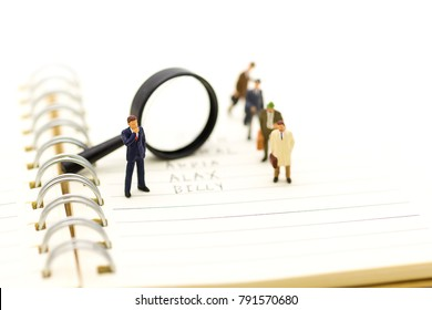 Miniature people, Supervisors look for employees for job placement, using as background Choice of the best suited employee, HR, HRM, HRD, job recruiter concepts.