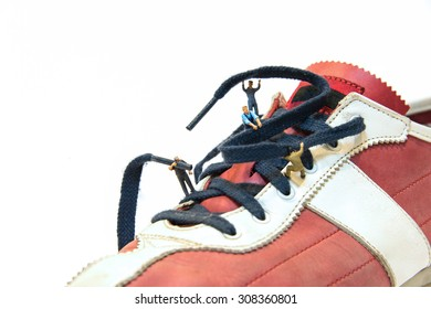 Miniature people are Tie shoelaces.