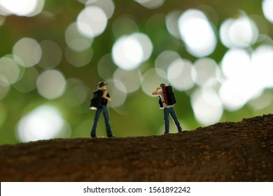 Miniature people :  tourism backpackers with outside nature isolated bokeh background