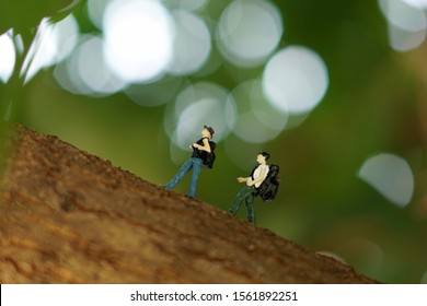 Miniature people :  tourism backpackers with outside nature