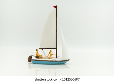 Miniature people: Tourists sail using as background traveling, exploring the world, business concept.