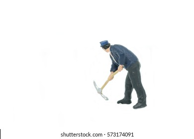 Miniature people Track workers construction concept on white background with a space for text.