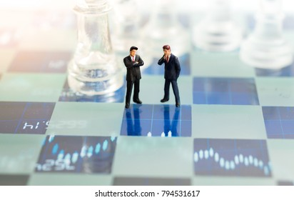 Miniature people, Two Businessmen standing on the chess game, thinking solution for the business game,  use as a business competition concept.