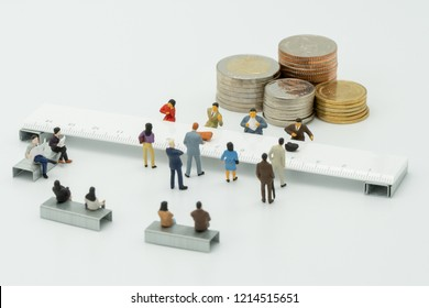 Miniature People use cash deposit. At the bank counter or financial institution. There are many users. as background business concept and Saving concept with  copy spaces for your text or design.