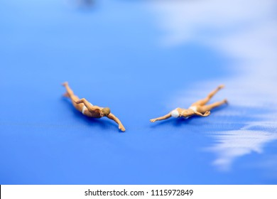Miniature people: Vacationers are enjoy to swimming.