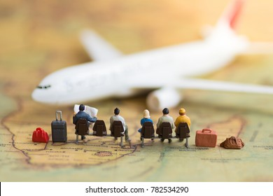 Miniature people : people waiting for plane using as background travel, business trip traveler adviser agency or transportation concept.