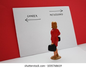 Miniature people, woman decides between a career and a child. Bilogical clock, feministmambitions, job or family dilemma conceptual photo.