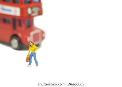 Miniature people woman on travel isolated on white background