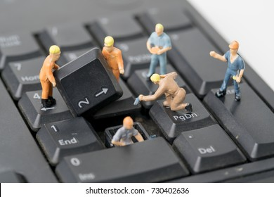 miniature people Work on Computer Keyboard