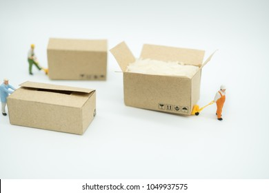 Miniature people: Worker and box in warehouse store with copy space using as background shipping, rent container, business concept.
